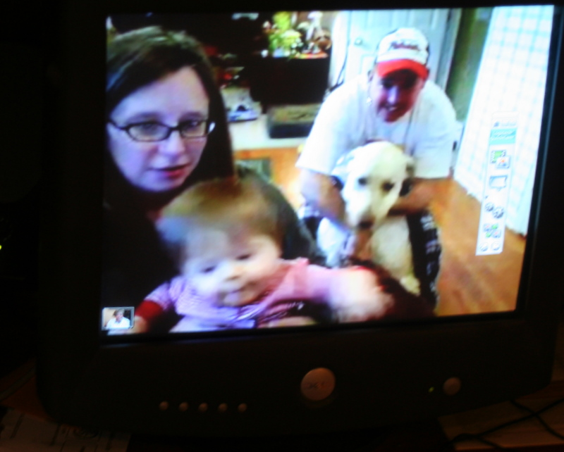 Wishing my brother Eric and his family a Merry Christmas via webcam... we all got them for Christmas!