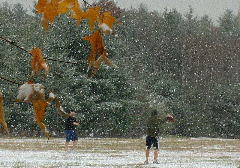 First snow of the season didn't stop the guys that play football at lunch...  the first 2 on the field even sported shorts.