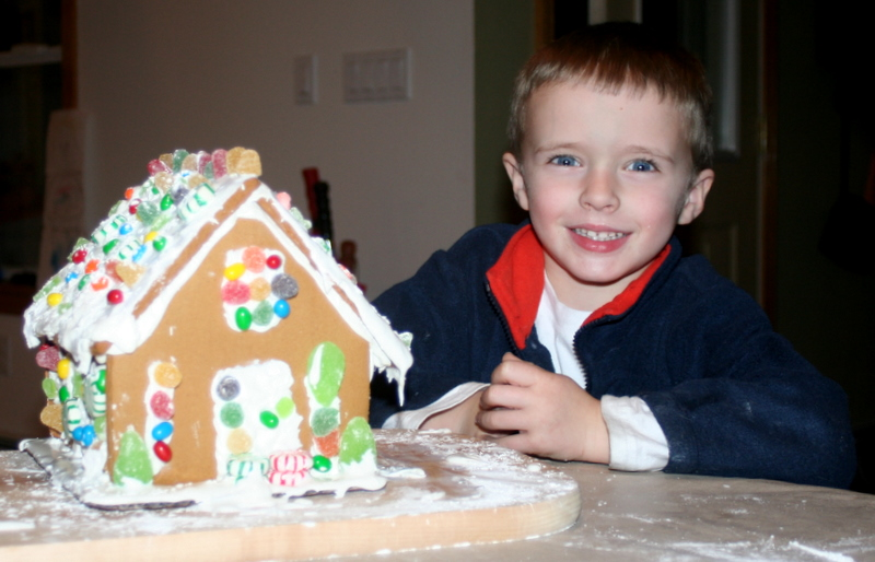 Tommy and his gingerbread house masterpiece...