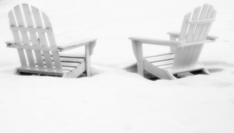 Adirondack chairs in the snow...