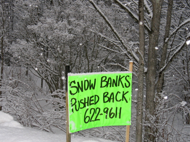 Sign of the times...need to push banks back with all this snow!