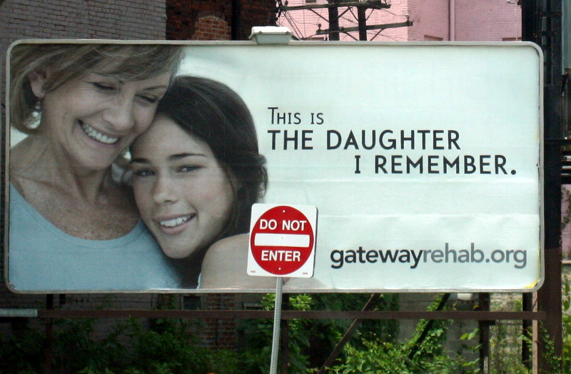 Not exactly the most conducive placement of the do not enter sign - at least as far as the billboard message goes...