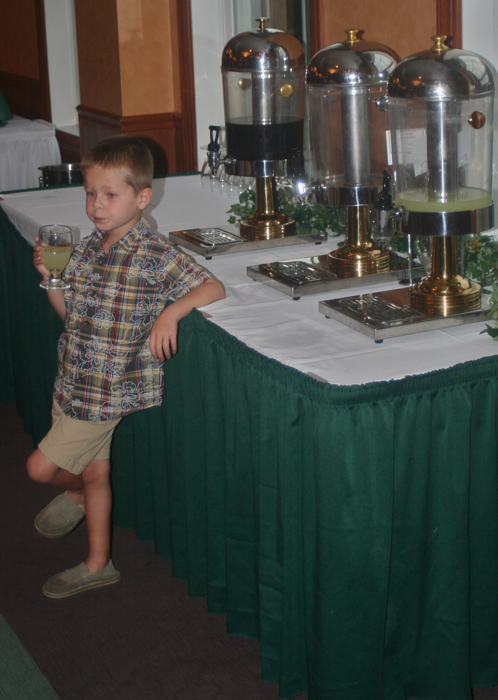 Jack at the family reunion making himself very comfortable at the lemonade station