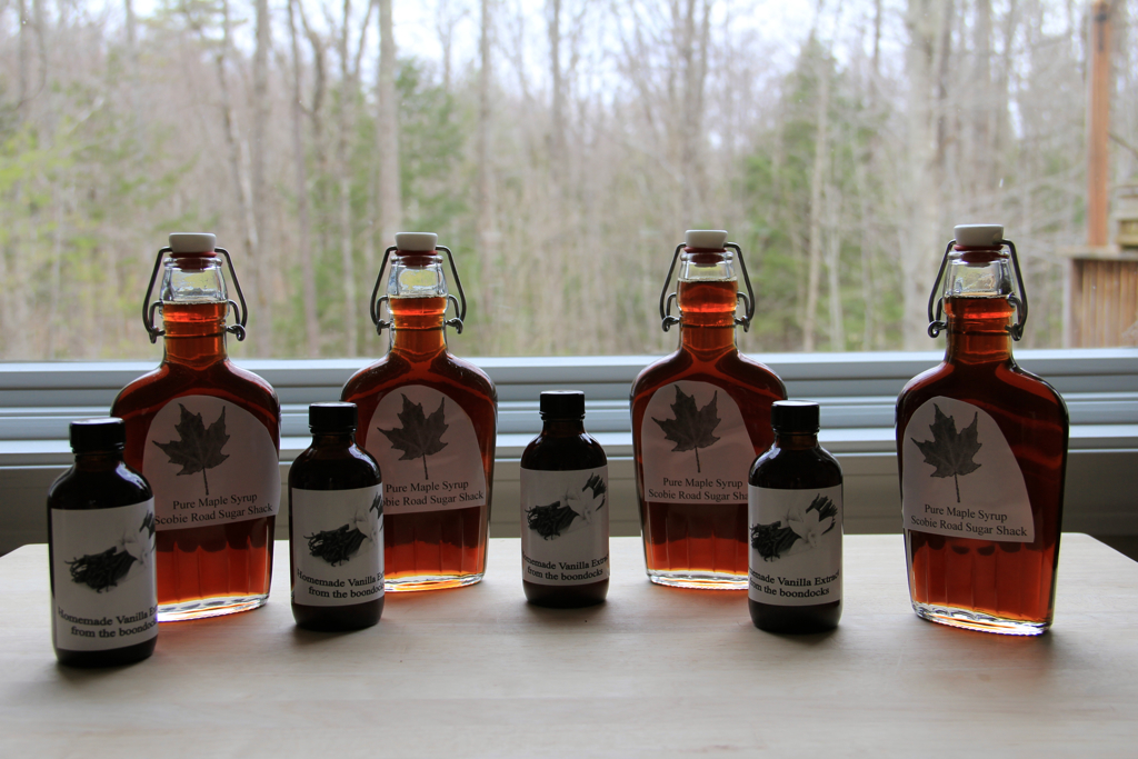 Our homemade vanilla extract bottled up along with re-bottled local maple syrup :)
