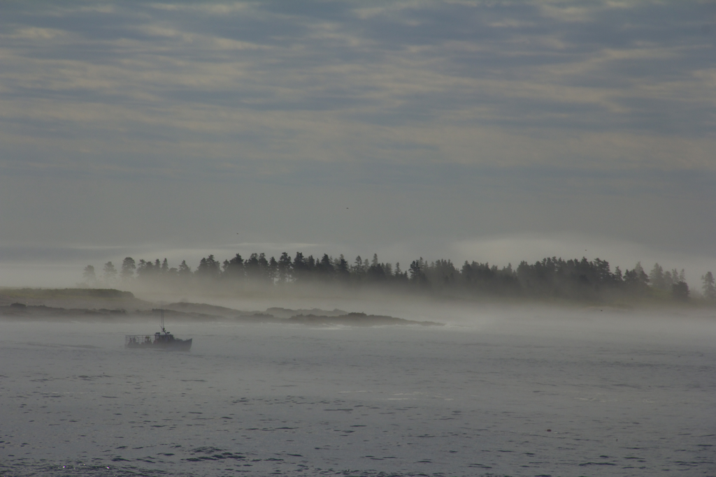 Lobster boat in the lifting fog...