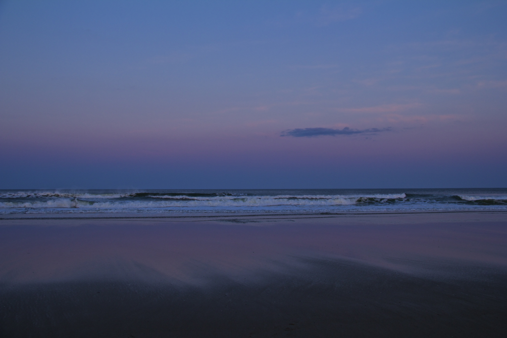 The beach putting on a display of Lenten penance purple on Easter Eve.