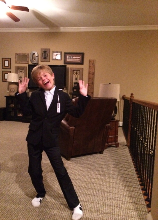 Jack modeling his new suit for the wedding... and showing off his dance moves