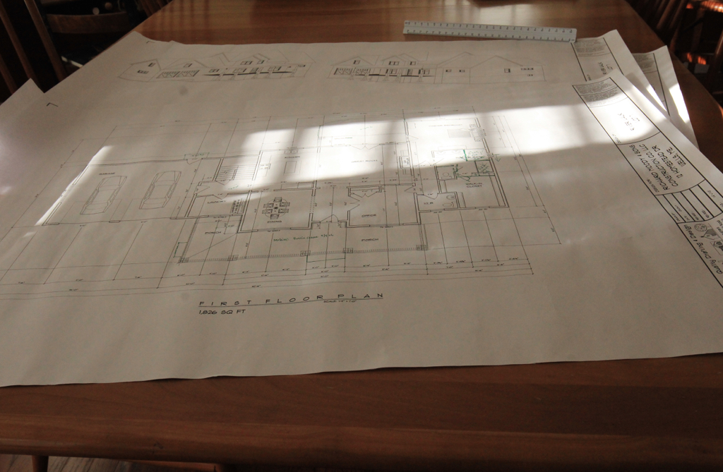 Morning sunshine on the first draft of our new house plans...